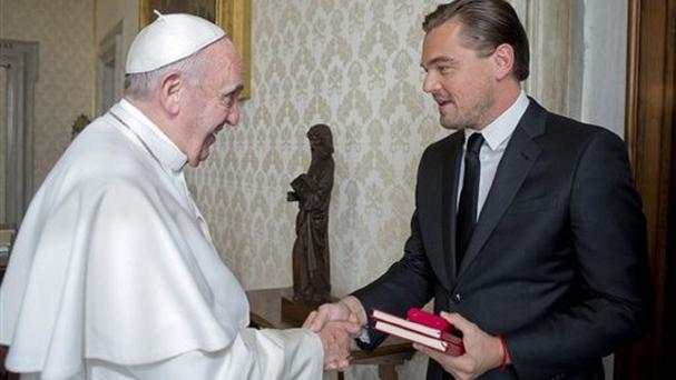 Pope Francis meets Leonardo DiCaprio during a private audience in the pontiff's private studio at the Vatican (L'Osservatore Romano/Pool Photo via AP)