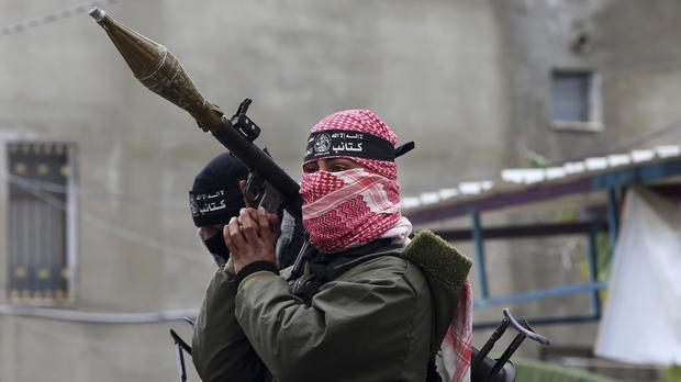 Palestinian militants attend the funeral of Hamas members killed repairing a tunnel in Gaza City (AP)