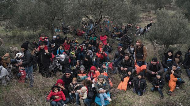 Migrants wait to travel to the Greek island of Lesbos (AP)