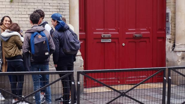 French students congregate outside a school in Paris. (AP)