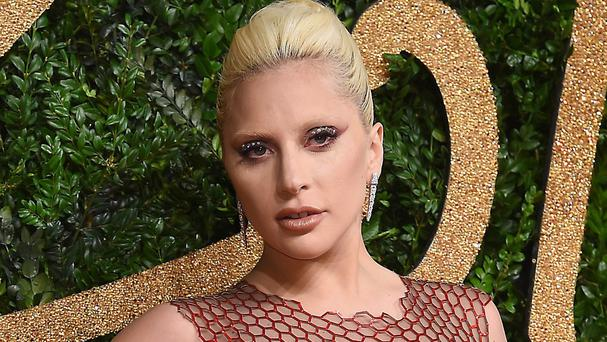 Lady Gaga, pictured at the British Fashion Awards 2015 in London, will sing the US national anthem at the Super Bowl (AP)