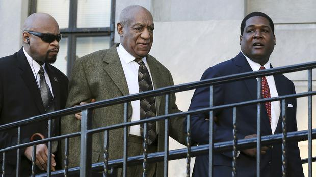 Bill Cosby, centre, arrives for a court appearance in Norristown (AP)