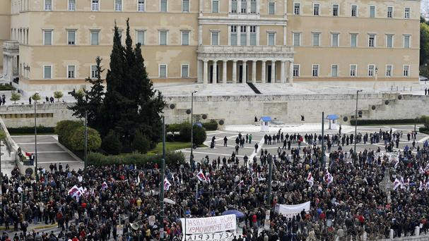 Protesters gather outside the Greek parliament in Athens during a 24-hour nationwide general strike. (AP)