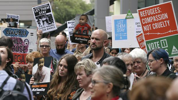 Protesters against asylum seekers being deported hold a rally in Sydney (AP)