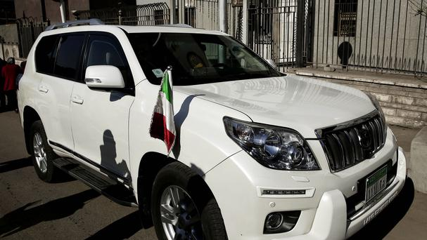 A vehicle belonging to the Italian ambassador is parked outside Zeinhom morgue, where Giulio Regeni's body is being held. (AP)