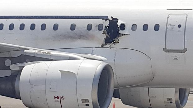 A gaping hole in the plane forced it to make an emergency landing. (AP)
