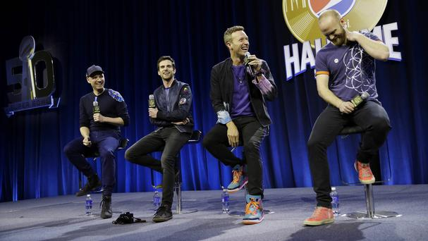 Jonny Buckland, Guy Berryman, Chris Martin and Will Champion of Coldplay discuss their SuperBowl appearance (AP)