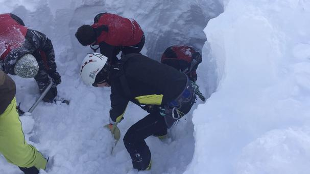 Mountain rescue service personnel search for skiers trapped in an avalanche in Austria (ZOOM.TIROL via AP)