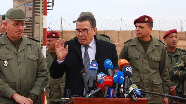Tunisian defence minister Farhat Horchani inspected the first completed part of the 122-mile fence (AP)