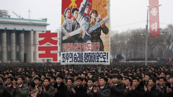Thousands of North Koreans gather at Kim Il Sung Square in Pyongyang to celebrate the satellite launch (AP)