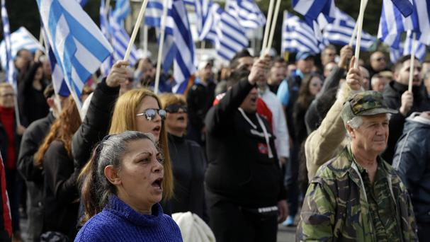 Protesters sing the national anthem of Greece during a rally organised by the extreme right Golden Dawn party (AP)