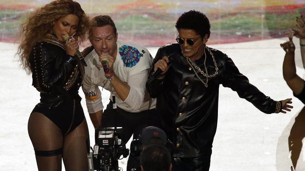 Coldplay singer Chris Martin, centre, with Beyonce and Bruno Mars at the Super Bowl half-time show (AP)