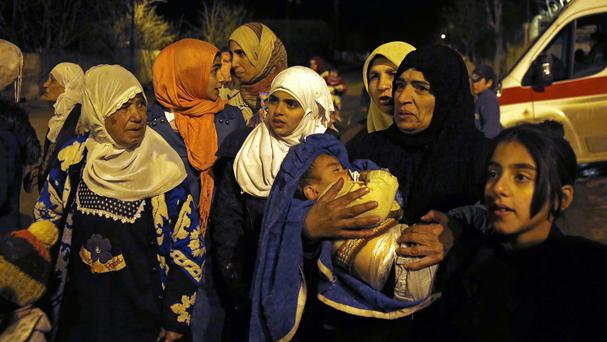 People wait to leave the besieged town of Madaya where Doctors Without Borders says dozens of people have died of starvation since September (AP)