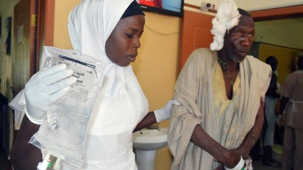 A victim of a suicide bomb attack at a refugee camp receives treatment at a hospital in Maiduguri, Nigeria (AP)