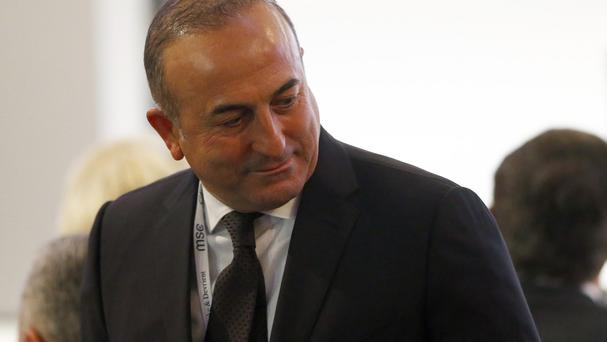Mevlut Cavusoglu was speaking after taking part in a security conference in Munich (AP)