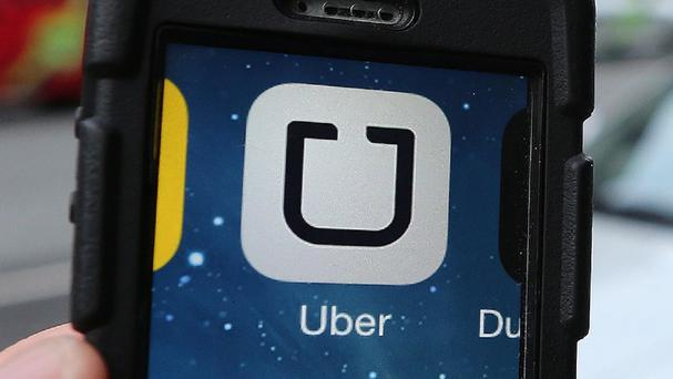 Uber has been embroiled in a number of safety scandals, and on Friday offered nearly $30m to settle a US lawsuit that argued its safety claims were misleading. (Stock photo)