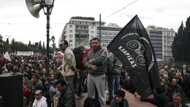Farmers take part in an anti-government protest in front of the parliament building in Athens