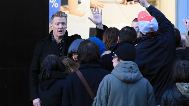 Eagles Of Death Metal's Josh Homme waves to fans as he arrives ahead of his concert at the Olympia music hall, in Paris (AP)
