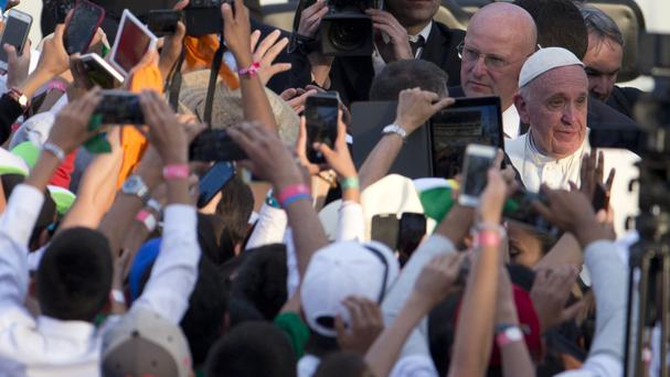 Pope Francis, right, meets the crowds in Morelia (AP)