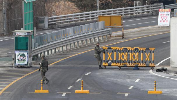 South Korean soldiers close a road at the customs, immigration and quarantine office near the border village of Panmunjom (AP)