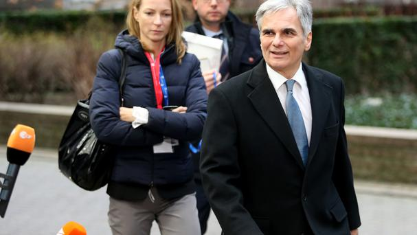Werner Faymann (right) arrives for an EU summit in Brussels (AP)