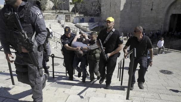 Israeli border police arrest a Palestinian at the Old City's Damascus Gate in Jerusalem (AP)