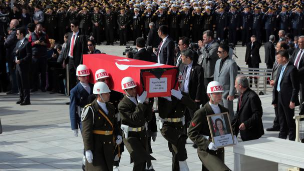 Soldiers carry a coffin as Turkish army commanders, ministers and family members attend funeral prayers for eight of the 28 victims (AP)