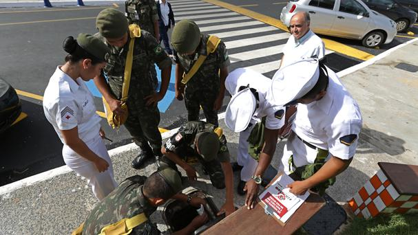 Soldiers conduct an inspection at a school in Brasilia (AP)
