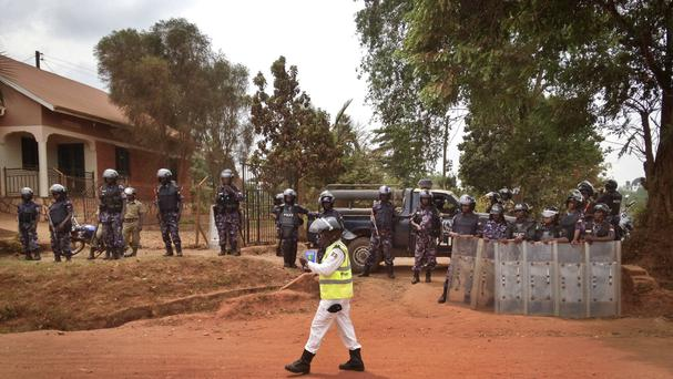 Ugandan police block the media and others from accessing opposition candidate Kizza Besigye (AP)