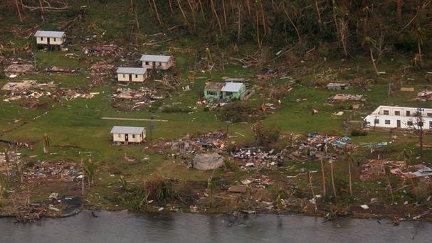 This aerial photo shows debris scattered around damaged buildings at Muamua on Vanua Blava Island in Fiji (New Zealand Defence Force/PA)
