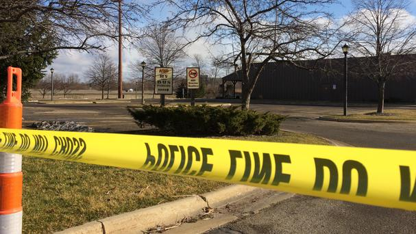 Police tape surrounds the area of a shooting in Kalamazoo (AP)