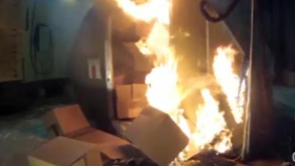 A test at the FAAs technical centre in Atlantic City, New Jersey, shows a blaze in a cargo container packed with 5,000 rechargeable lithium-ion batteries (FAA/AP)