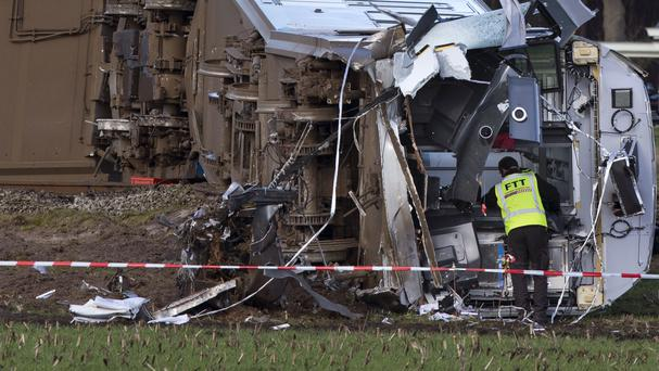 Investigators look for evidence at the wreck of commuter train which derailed near Dalfsen (AP)