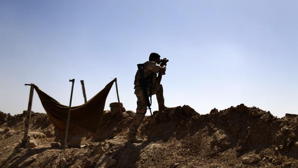 Iraqi Kurdish peshmerga forces are fighting IS militants to the north and east of Mosul (AP)