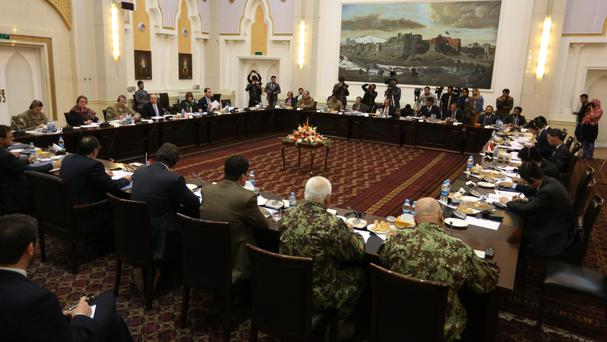 Delegations from Afghanistan, Pakistan, the US and China discuss a road map for ending the war with the Taliban (AP)