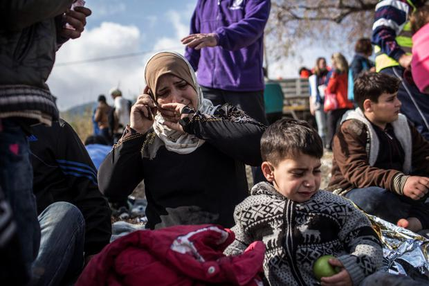 A Syrian woman cries as she talks to her relatives after her arrival on the island of Lesbos in Greece yesterday. Photo: AP