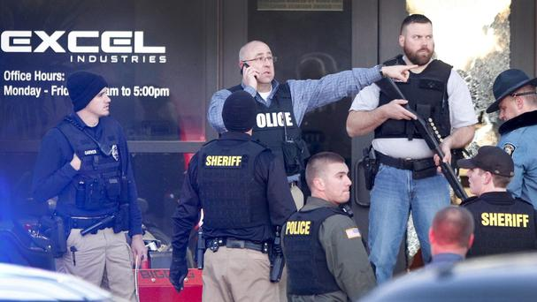 Police guard the front door of Excel Industries following the gun rampage (The Wichita Eagle/AP)