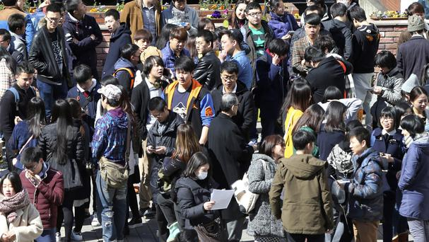 People in a square near a railway station in Tokyo as results of the 2015 census show Japan's population dropped by 947,000 people in the last five years (AP)