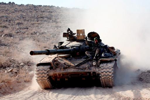 THE HEAVY ARMOUR: A Syrian government tank in an operation against Isil near Aleppo. Photo: Georges Ourfalian/Getty