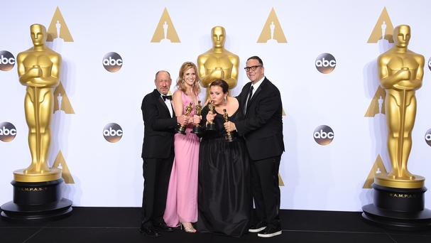 The producers of best picture Spotlight pose in the press room with their Oscars (Invision/AP)