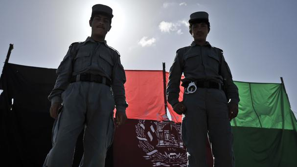 An Afghan policeman has shot dead four colleagues at a checkpoint