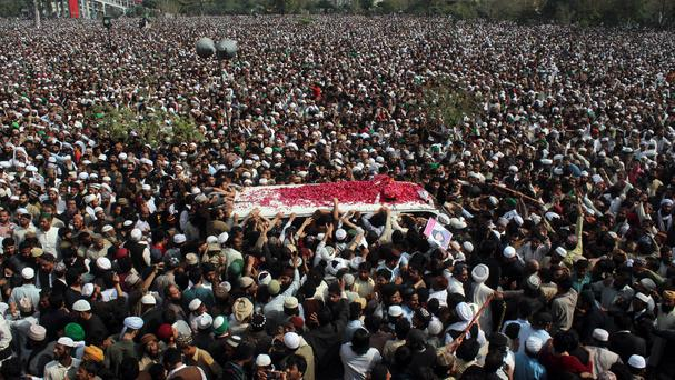 Thousands of people attend the funeral of police officer Mumtaz Qadri in Rawalpindi, Pakistan (AP)