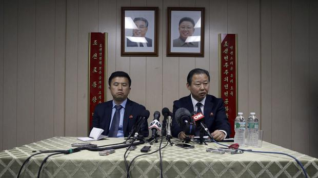 North Korea's UN ambassador Jang Il Hun, right, and councillor Kwon Jong Gun speaking in New York in July 2015 as a UN vote on sanctions was delayed (AP)