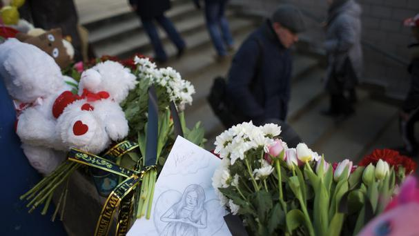 Floral tributes outside a subway station in Moscow (AP)