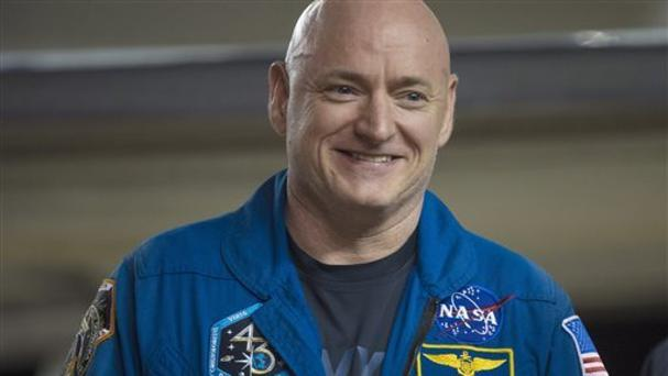 Scott Kelly of Nasa smiles after arriving at Ellington Field in Houston, Texas (AP)