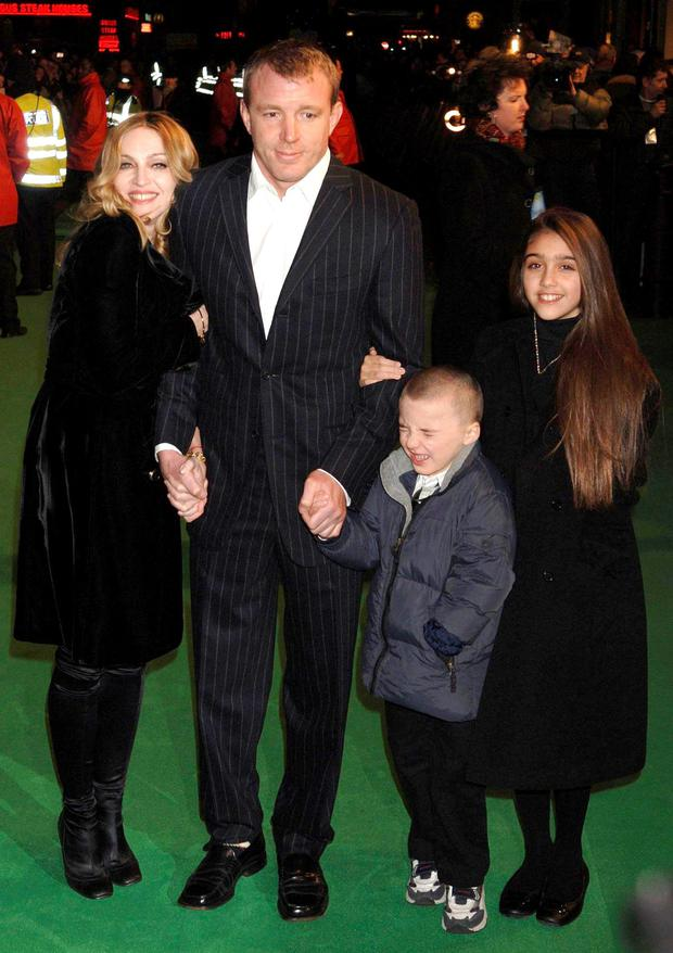 Madonna and Guy Ritchie with their children, Lourdes and Rocco, in happier times back in 2008. Photo: Yui Mok/PA Wire