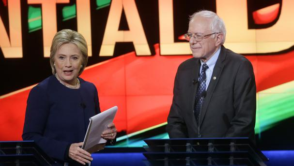 Hillary Clinton and Bernie Sanders at the Democratic presidential primary debate in Michigan (AP)