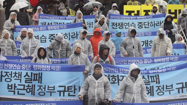 South Korean protesters stage a rally criticising joint military exercises between the US and Seoul (AP)