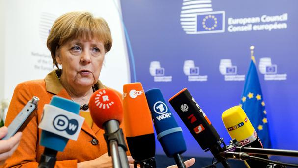 Angela Merkel has raised the issue of human rights with Turkey's prime minister (AP)