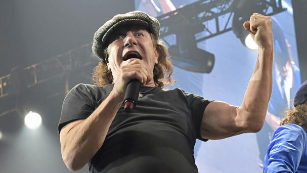 Brian Johnson has been told to stop touring or risk total hearing loss (Invision/AP)